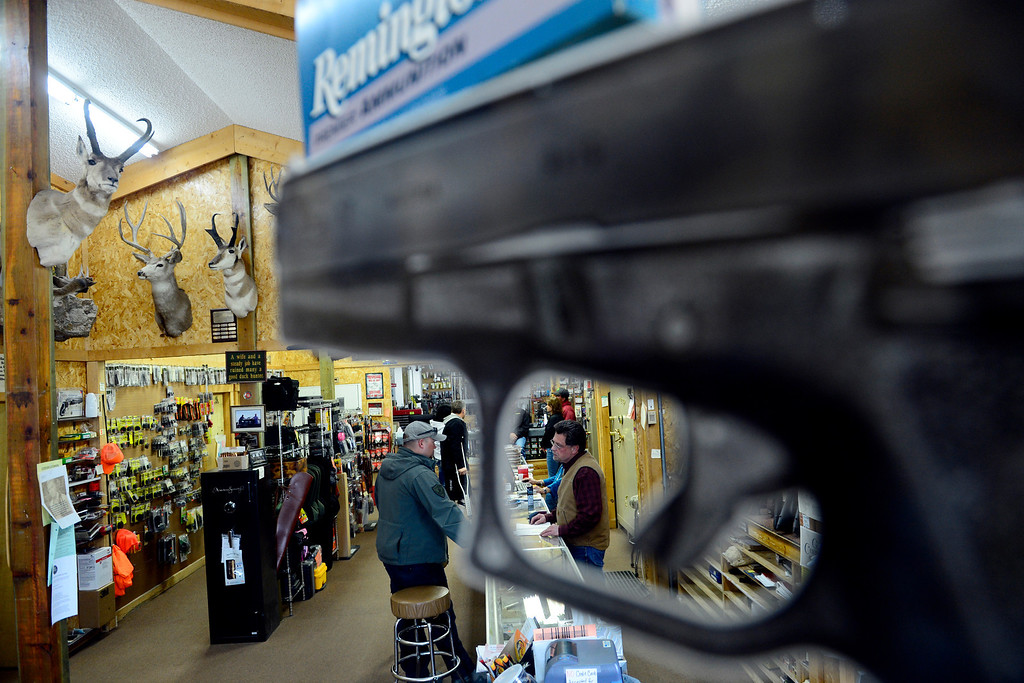 . MONTE VISTA, CO - FEBRUARY 26: Carlton Thomas helps a customer at Valley Gun in Monte Vista. Gun owners in southern Colorado largely agree that responsible ownership begins at home. (Photo by AAron Ontiveroz/The Denver Post)
