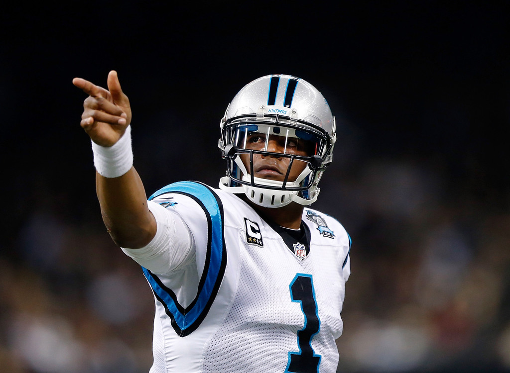 . Cam Newton #1 of the Carolina Panthers celebrates after scoring a touchdown in the first half against the New Orleans Saints  at Mercedes-Benz Superdome on December 7, 2014 in New Orleans, Louisiana.  (Photo by Sean Gardner/Getty Images)