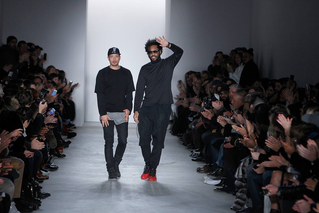 . Fashion designers Dao-Yi Chow, left, and Maxwell Osborne walk the runway at the Public School Fall 2015 collection during Fashion Week on Sunday, Feb. 15, 2015, in New York. (AP Photo/Mark Von Holden)