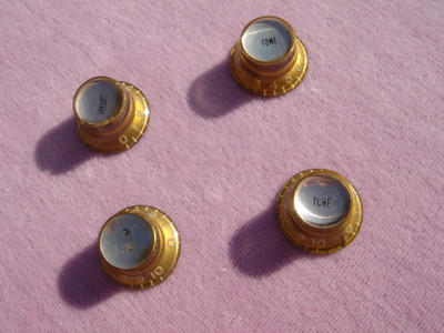 Mid 60's amber reflector knobs set 1