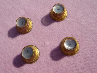 Mid 60's amber reflector knobs set 1