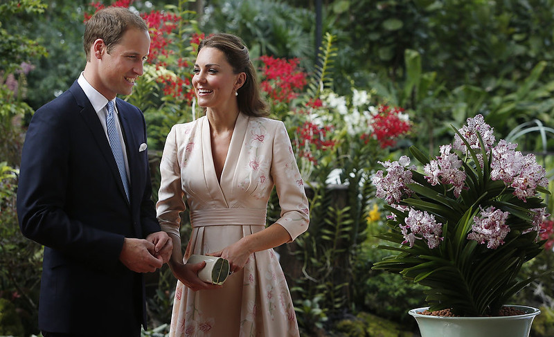 . Catherine, Duchess of Cambridge and Prince William, Duke of Cambridge smile as they look at an orchid named in honor of Diana, Princess of Wales at Singapore Botanical Gardens on September 11, 2012 in Singapore.  (Photo by Danny Lawson - Getty Images)