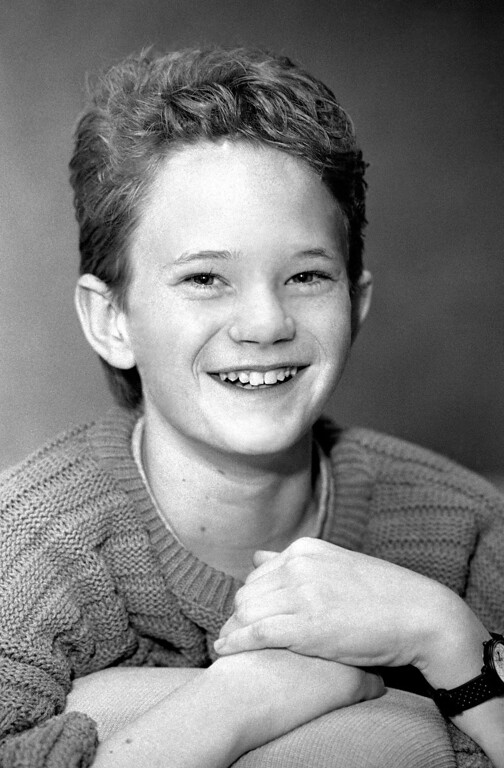 """. Young actor Neil Patrick Harris, 15, who co-starred with Whoopi Goldberg in """"Clara\'s Heart,"""" smiles for the camera in Los Angeles, Jan. 21, 1989.   (AP Photo/Reed Saxon)"""