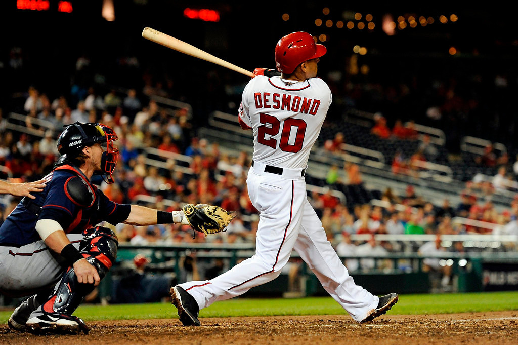 . Ian Desmond #20 of the Washington Nationals hits a RBI double in the seventh inning during game two of a doubleheader against the Minnesota Twins at Nationals Park on June 9, 2013 in Washington, DC.  (Photo by Patrick McDermott/Getty Images)