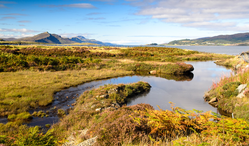 Stream flowing into the sea on the Isle of Skye