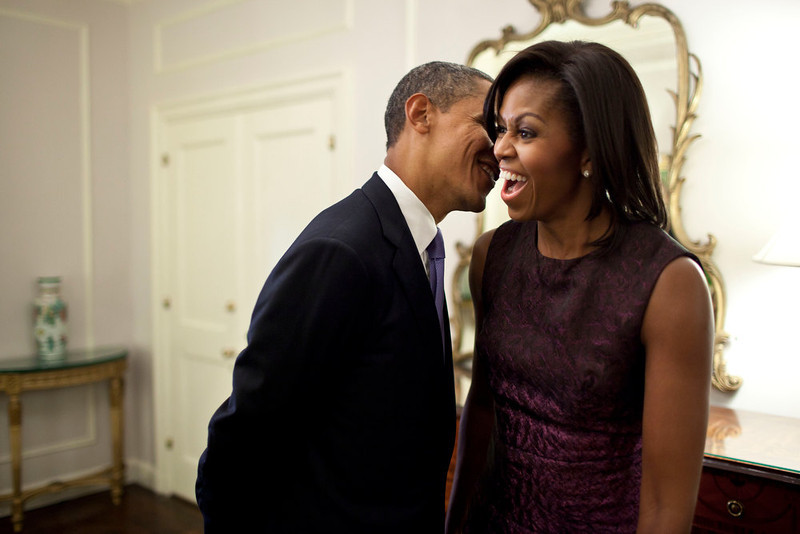 ". Sept. 21, 2011 ""The First Lady reacts to something the President whispered to her at the Waldorf Astoria Hotel in between events related to the United Nations General Assembly in New York City.\""   (Official White House Photo by Pete Souza)"