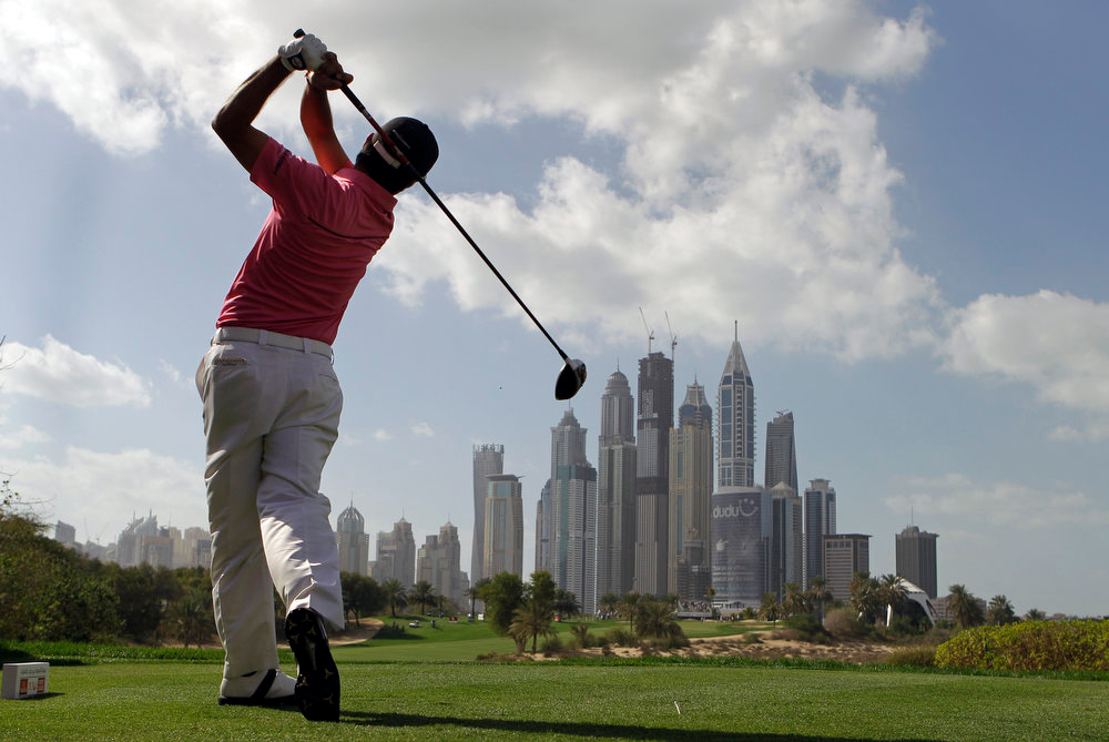 Description of . Felipe Aguilar from Chile plays a ball on the 8th hole during final round of the Dubai Desert Classic Golf tournament in Dubai, United Arab Emirates, Sunday, Feb.3, 2013. (AP Photo/Kamran Jebreili)