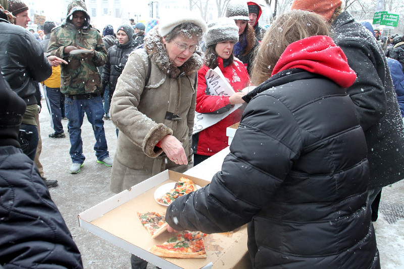 """The now world famous Ian's Pizza being provided to thousands of protestors by sponsors around the world - including one from Egypt.  It started on February 21st, when someone asked if Ian's could give the protestors staying in the capital building any """"left over"""" pizza.  The next day a women in California placed a carry out tweet for two Pizzas for protestors."""