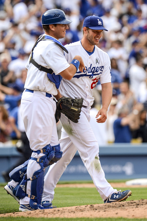 . Dodger\'s Clayton Kershaw is congratulated by A.J. Ellis after his win on opening day at Dodger Stadium Monday.  Dodgers defeated the Giants 4-0.  Photo by David Crane/Los Angeles Daily News.