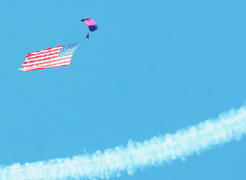 . Jim Bobel/JBobel@MorningJournal.com The Discover Aviation Air Show at the Lorain County Regional Airport opened with a sky diving team bringing the flag in from the sky.