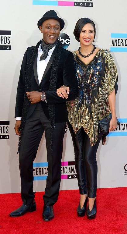 . Aloe Blacc (L) and Maya Jupiter arrives to the American Music Awards  at the Nokia Theatre in Los Angeles, California on Sunday November 24, 2013 (Photo by Andy Holzman / Los Angeles Daily News)