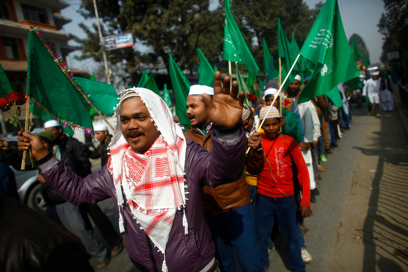 . Nepalese Muslims participate in a rally to mark Milad-un-Nabi, the festival that commemorates the birthday of Prophet Muhammad in Katmandu, Nepal, Tuesday, Jan. 14, 2014. Muslims are a minority in this predominantly Hindu Himalayan nation. (AP Photo/Niranjan Shrestha)