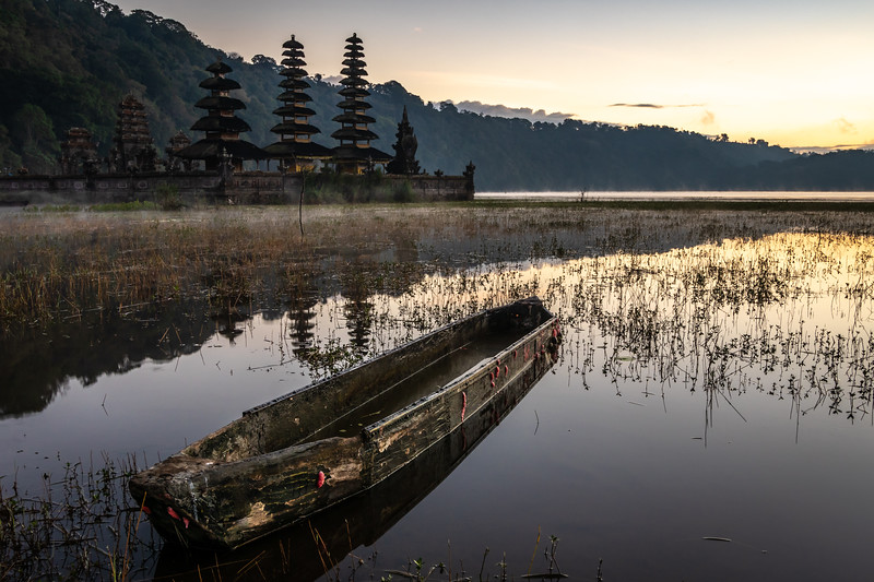 Vintage canoe and temple