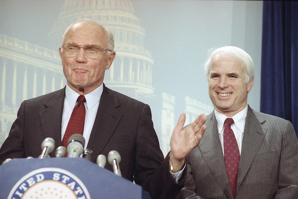 . Sen. John Glenn, (D-Ohio), left, and Sen. John McCain, (R-Ariz.), smile on Tuesday, Oct. 23, 1990 during a news conference on Capitol Hill in Washington. A special counsel for the Senate Ethics Committee recommends dismissal of the cases against the two senators? involvement in the ?Keating Five? investigation. (AP Photo/John Duricka)