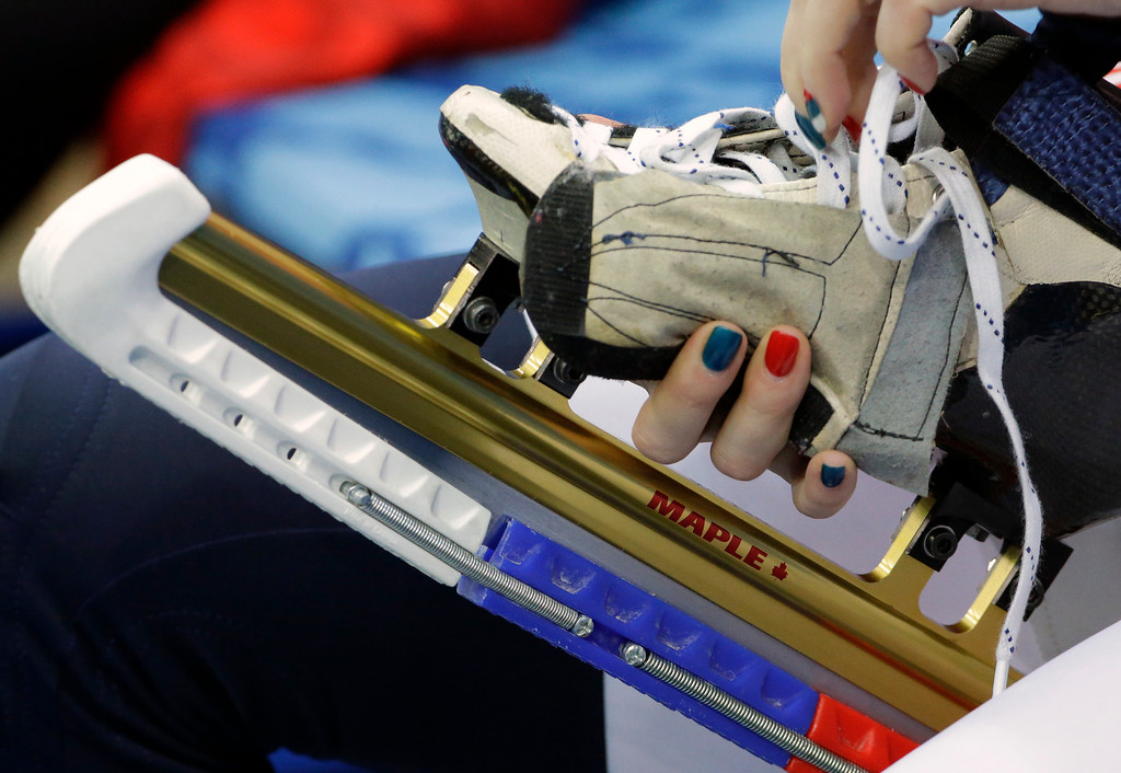 . Tatiana Borodulina of Russia laces up before the start of the short track speedskating competition at the Iceberg Skating Palace during the 2014 Winter Olympics, Tuesday, Feb. 18, 2014, in Sochi, Russia. (AP Photo/David J. Phillip)