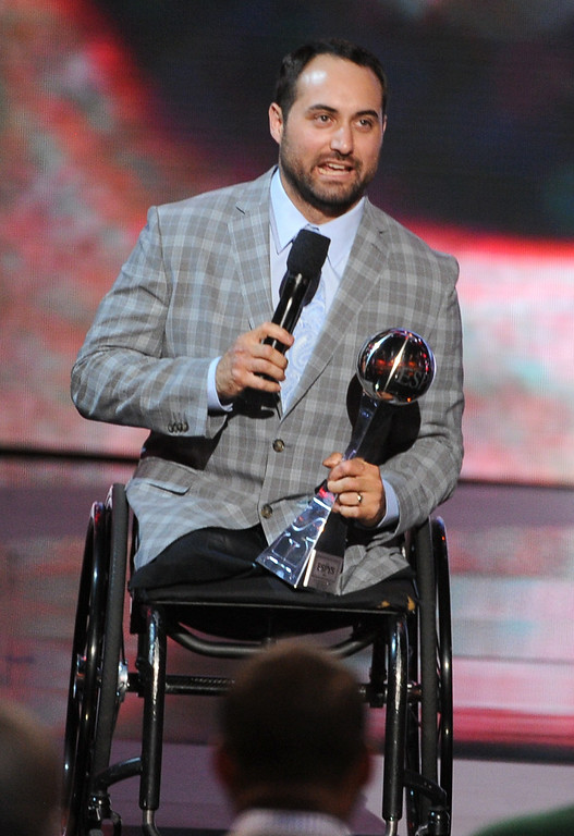. LOS ANGELES, CA - JULY 16:  U.S. Paralympic Sled Hockey Team athlete Josh Sweeney accepts the Pat Tillman Award for Service onstage during the 2014 ESPYS at Nokia Theatre L.A. Live on July 16, 2014 in Los Angeles, California.  (Photo by Kevin Winter/Getty Images)
