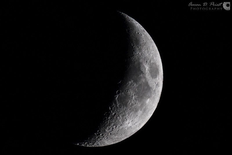 Handheld photo of a crescent moon taken on September 23, 2017, 18:57 in Lee, Maine with a Nikon D850, 200-500mm f/5.6, and TC20E-III 2x teleconverter at 1000mm, f/18, ISO 800, 1/60sec.