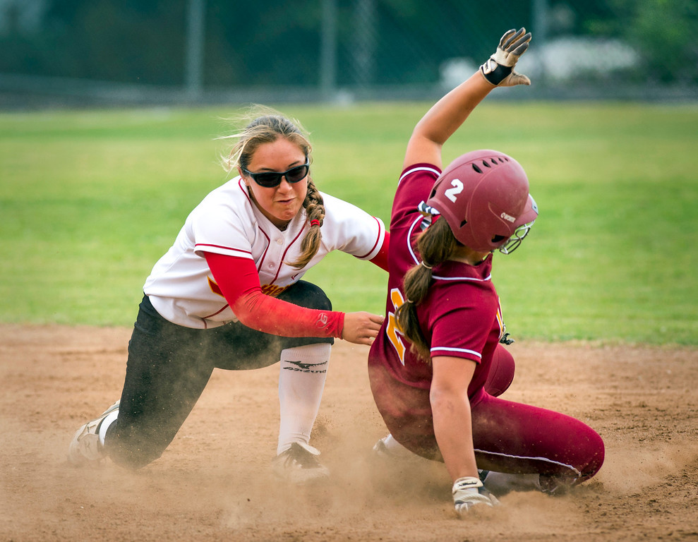 . Whittier Christian High 2B Erica Romo tags La Serna High\'s Danielle Garcielita out before dropping the ball in the fourth inning vs  at La Serna\'s Whittier campus field March 25, 2014.  (Staff photo by Leo Jarzomb/Whittier Daily News)