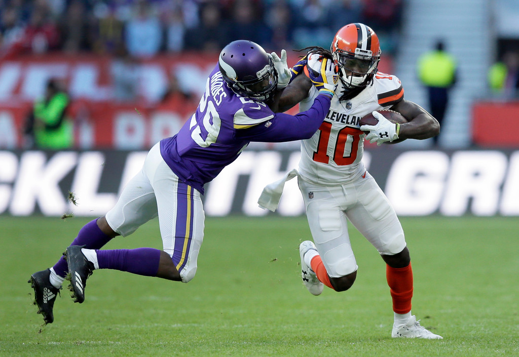 . Cleveland Browns wide receiver Sammie Coates (10) runs with the ball as Minnesota Vikings cornerback Xavier Rhodes, left, defends during the second half of an NFL football game at Twickenham Stadium in London, Sunday Oct. 29, 2017. (AP Photo/Tim Ireland)