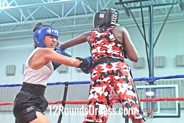Bout #8: Kayla Huff, Red Gloves vs Marie Alahdiah, Blue Gloves, 1-1/2  min. rds.
