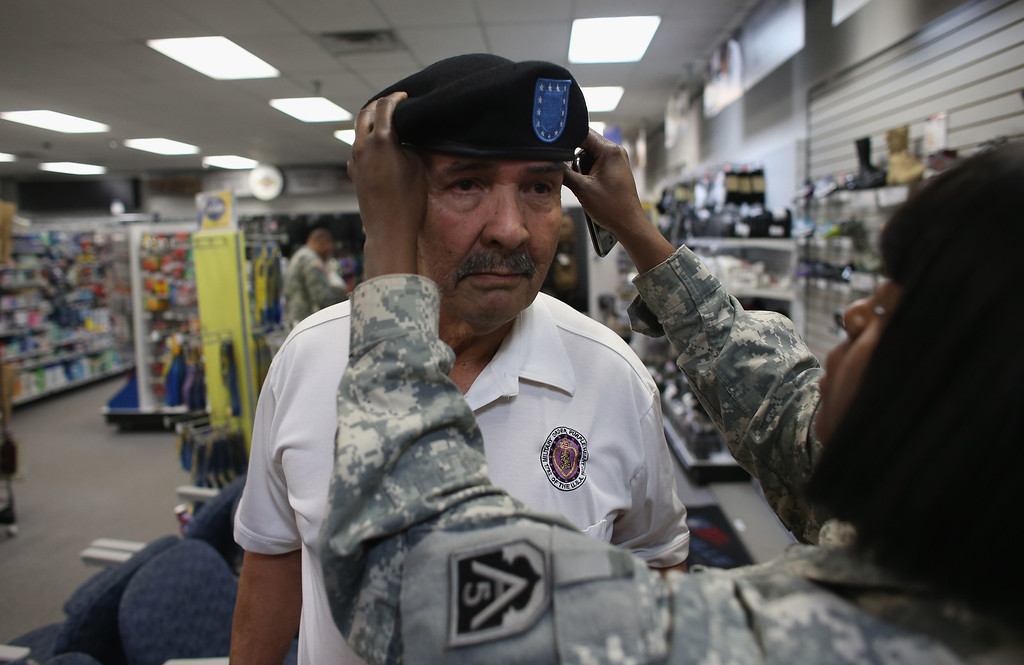 . U.S. Army Specialist Four Santiago J. Erevia with the help of Sgt. Kimberly Green picks out a beret for his new military uniform to be worn during the Medal of Honor ceremony at the White House on March 18th for his actions while serving in the Vietnam war on March 11, 2014 in San Antonio, Texas.   (Photo by Joe Raedle/Getty Images)