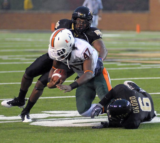 Okoro and Orange tackle Byrd.jpg