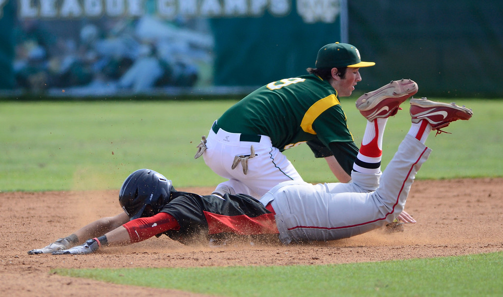 . Westchester runner 2 Aaron Greenfield is safe on a steal at second as MC 9 Mateo Nieto covers. Mira Costa defeated Westchester 2-1 at home in boy\'s baseball.  Photo by Brad Graverson 3-26-13