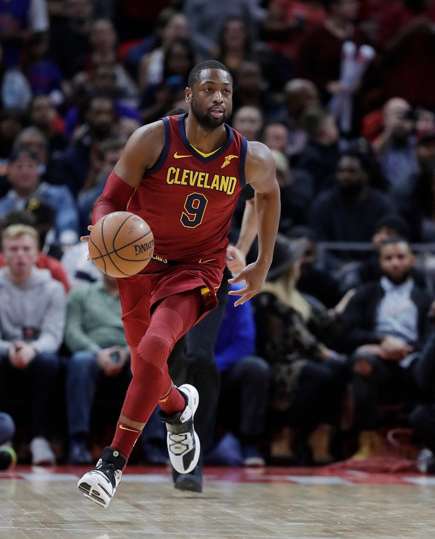. Cleveland Cavaliers guard Dwyane Wade brings the ball up court during the second half of an NBA basketball game, Monday, Nov. 20, 2017, in Detroit. (AP Photo/Carlos Osorio)