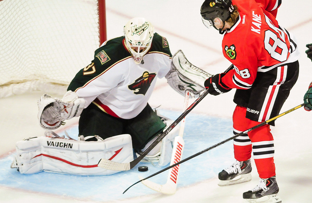 . Chicago Blackhawks right wing Patrick Kane takes a shot and is blocked by Minnesota Wild goalie Josh Harding in the third period. (Pioneer Press: Ben Garvin)