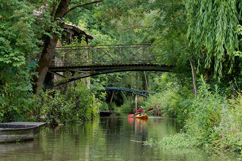 Kayaker in a small canal in Irleau.
