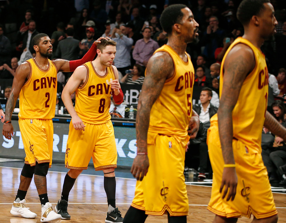 . Cleveland Cavaliers guard Kyrie Irving (2) leaves the court with Cavaliers guards Matthew Dellavedova (8) Cavaliers guard J.R. Smith (5), and other teammates in the second half of an NBA basketball game, Thursday, March 24, 2016, in New York. The Nets beat the Cavaliers 104-95. (AP Photo/Kathy Willens)