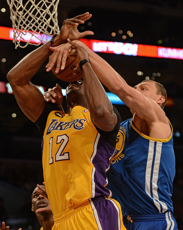 . The Dwight Howard #12 is fouled by the Warriors\' Andris Biedrins #15 during their game at the Staples Center in Los Angeles Friday, April 12, 2013. (Hans Gutknecht/Staff Photographer)
