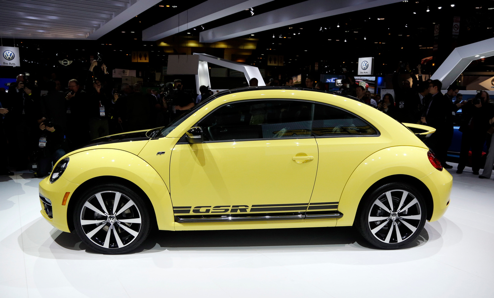 Description of . Volkswagen's Beetle GSR is presented during the media preview of the Chicago Auto Show at McCormick Place in Chicago on Thursday, Feb. 7, 2013. (AP photo/Nam Y. Huh)