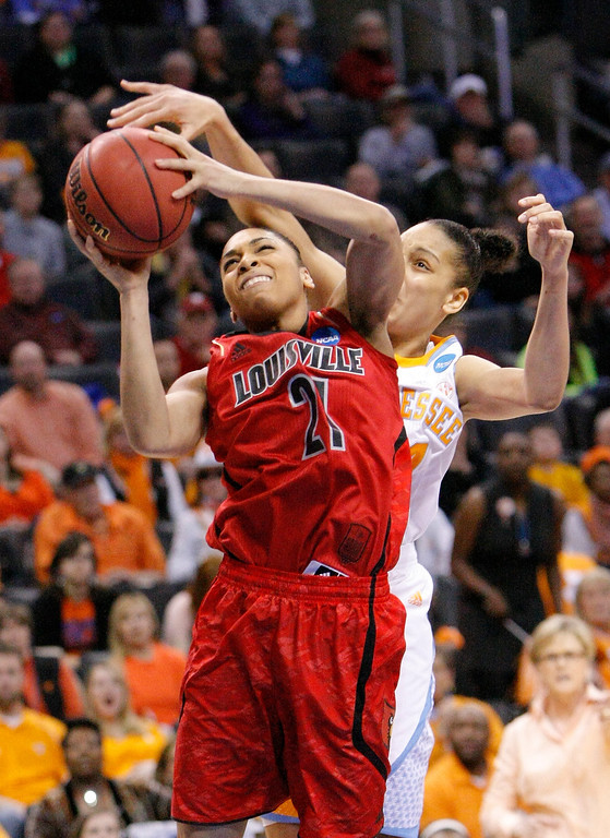 . Louisville\'s Bria Smith, front, is fouled by Tennessee\'s Cierra Burdick, back, during the first half of the Oklahoma City regional final in the NCAA women\'s college basketball tournament in Oklahoma City, Tuesday, April 2, 2013. (AP Photo/Alonzo Adams)