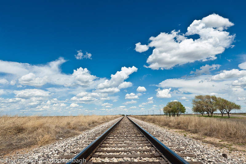 Rail Road and Clouds in a blue Sky