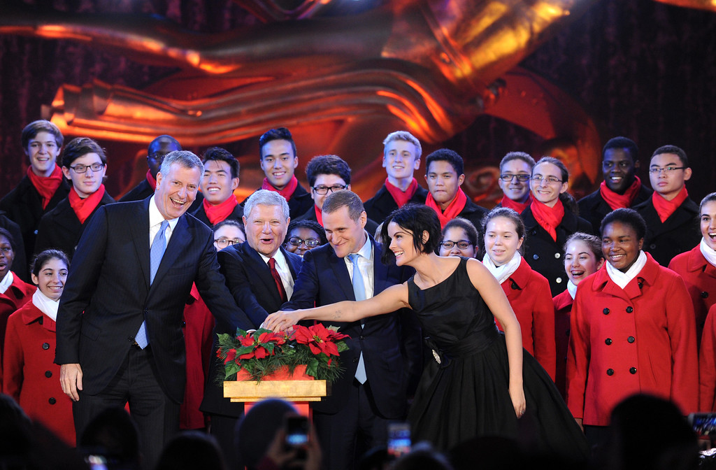 . IMAGE DISTRIBUTED FOR TISHMAN SPEYER - New York City Mayor Bill de Blasio, left, Jerry Speyer, second left, Rob Speyer, second right, and actress Jaimie Alexander, right, light the 2015 Rockefeller Center Christmas Tree, Wednesday, Dec. 2, 2015 in New York. (Photo by Diane Bondareff/Invision for Tishman Speyer/AP Images)