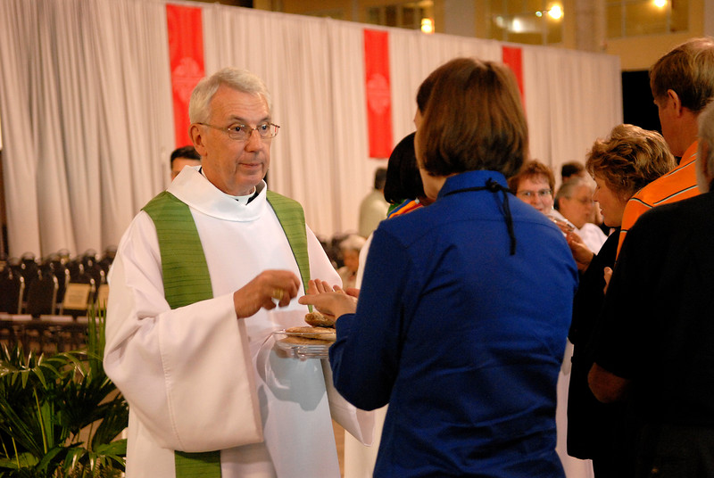 Secretary Lowell Almen serves Holy Communion at Wednesdays worship service of the 2007 ELCA Churchwide Assembly.