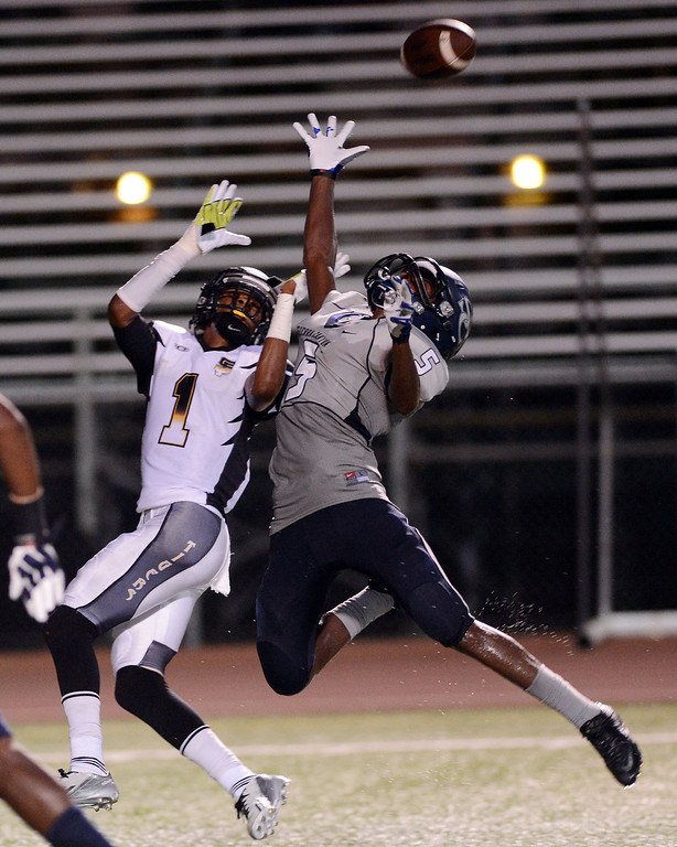. Sierra Canyon\'s Eric Markes #5 breaks up a pass intended for  San Fernando\'s Charles Bell #1 during their game at Granada Hills High School in Granada Hills Friday, August 30, 2013. (Hans Gutknecht/Los Angeles Daily News)