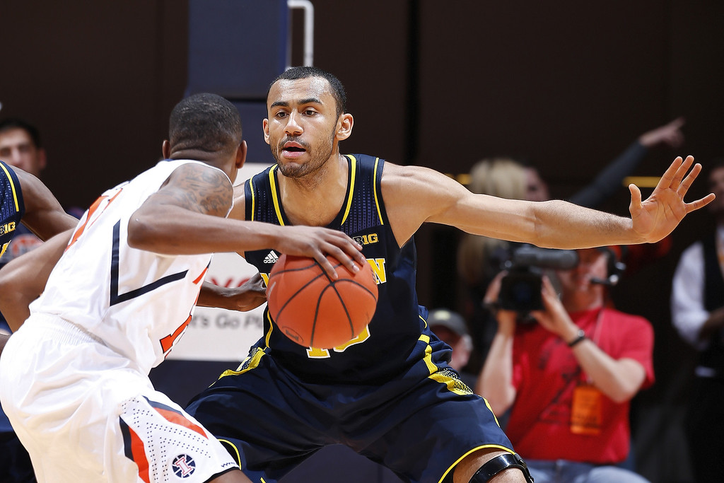 . CHAMPAIGN, IL - MARCH 4:  Jon Horford #15 of the Michigan Wolverines defends against the Illinois Fighting Illini during the game at State Farm Center on March 4, 2014 in Champaign, Illinois. Michigan defeated Illinois 84-53. (Photo by Joe Robbins/Getty Images)