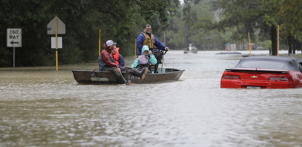 . Residents are evacuated from their flooded homes as floodwaters from Tropical Storm Harvey rise Monday, Aug. 28, 2017, in Spring, Texas. (AP Photo/David J. Phillip)
