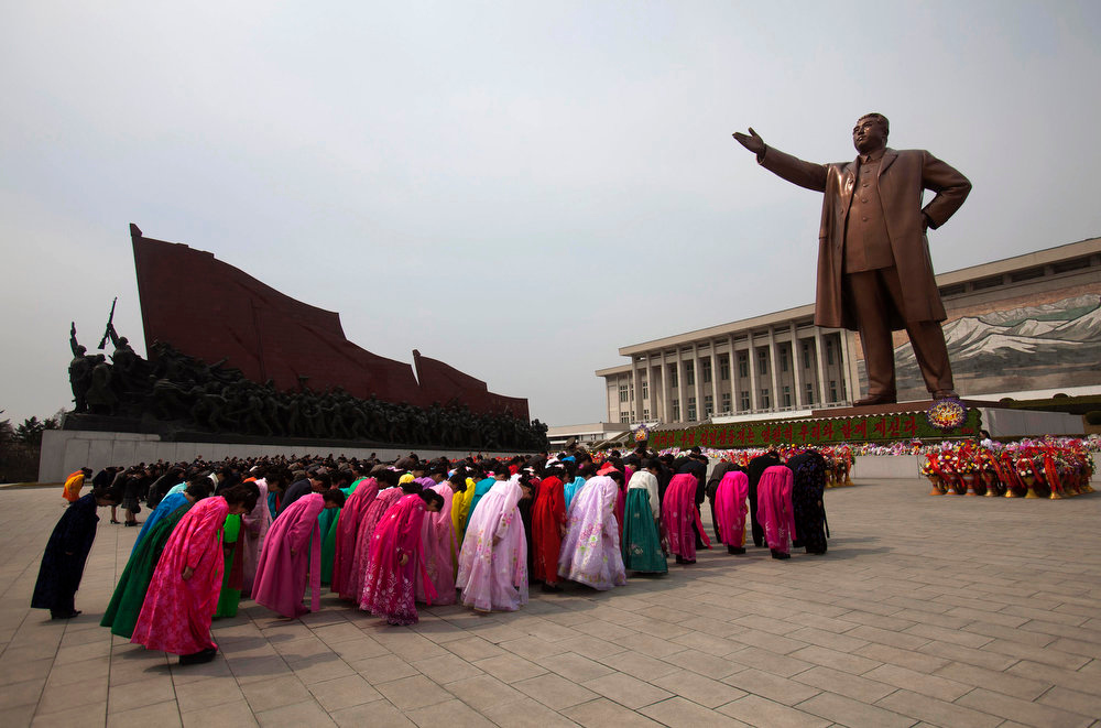 ". North Koreans pay their respects before a monument of Kim Il Sung at Mansu Hill in Pyongyang, North Korea, Thursday April 14, 2011. People began to celebrate on the eve of 99th anniversary of Kim Il Sung\'s birthday. April 15 is called ""The Day of the Sun\"" in honor of the former guerrilla fighter who founded North Korea in 1948. (AP Photo/David Guttenfelder)"