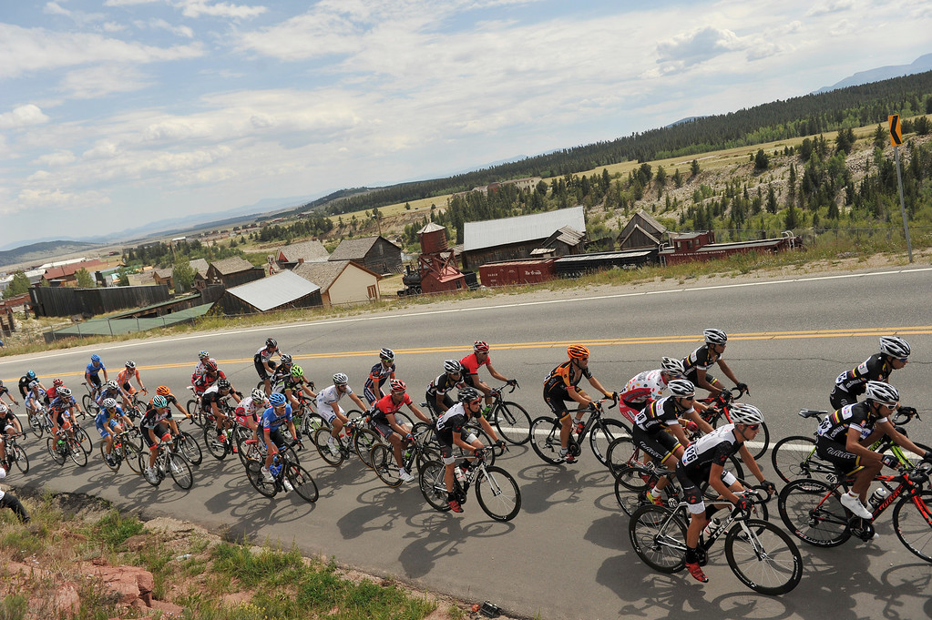 . The rides race past the Buena Vista History Museum during the second stage of the 2013 USA Pro Challenge race from Aspen to Breckenridge.  (Photo By Hyoung Chang/The Denver Post)
