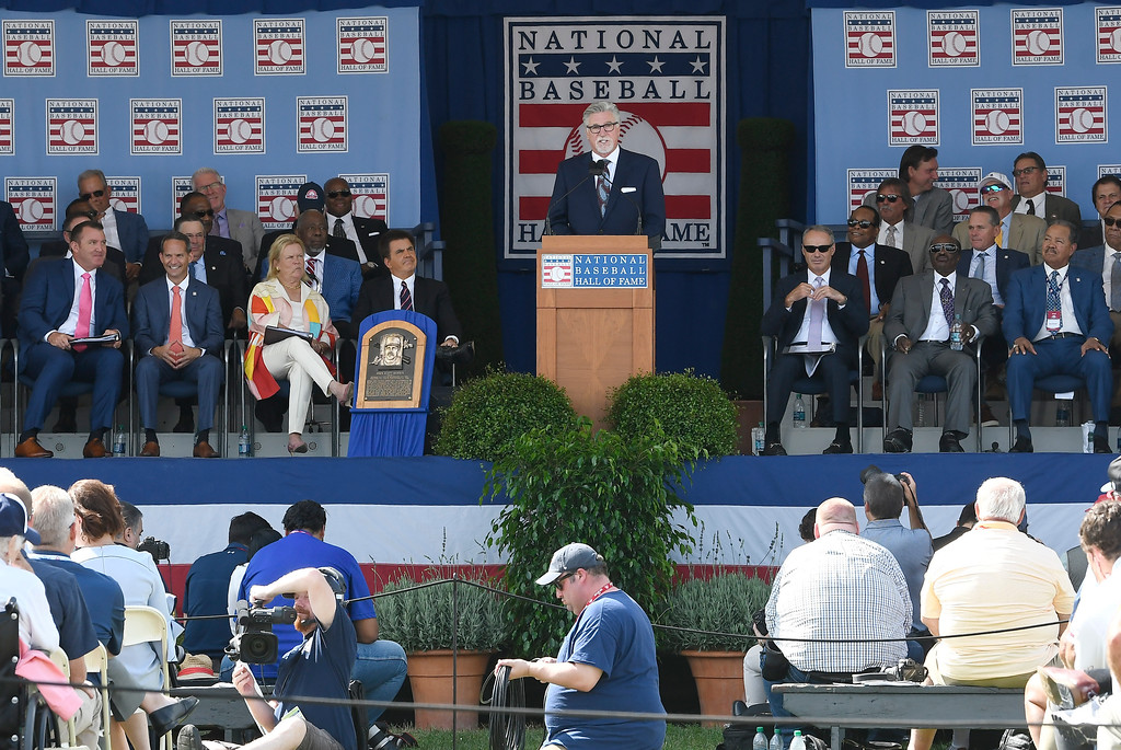 . National Baseball Hall of Fame inductee Jack Morris, top center, speaks during an induction ceremony at the Clark Sports Center on Sunday, July 29, 2018, in Cooperstown, N.Y. (AP Photo/Hans Pennink)