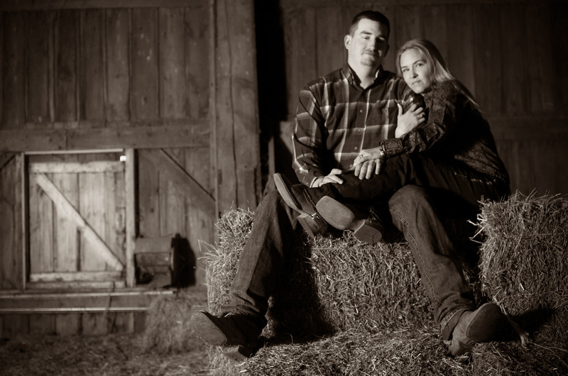 Couple in a barn during winter engagement photos near Severson Dells in Rockford, IL