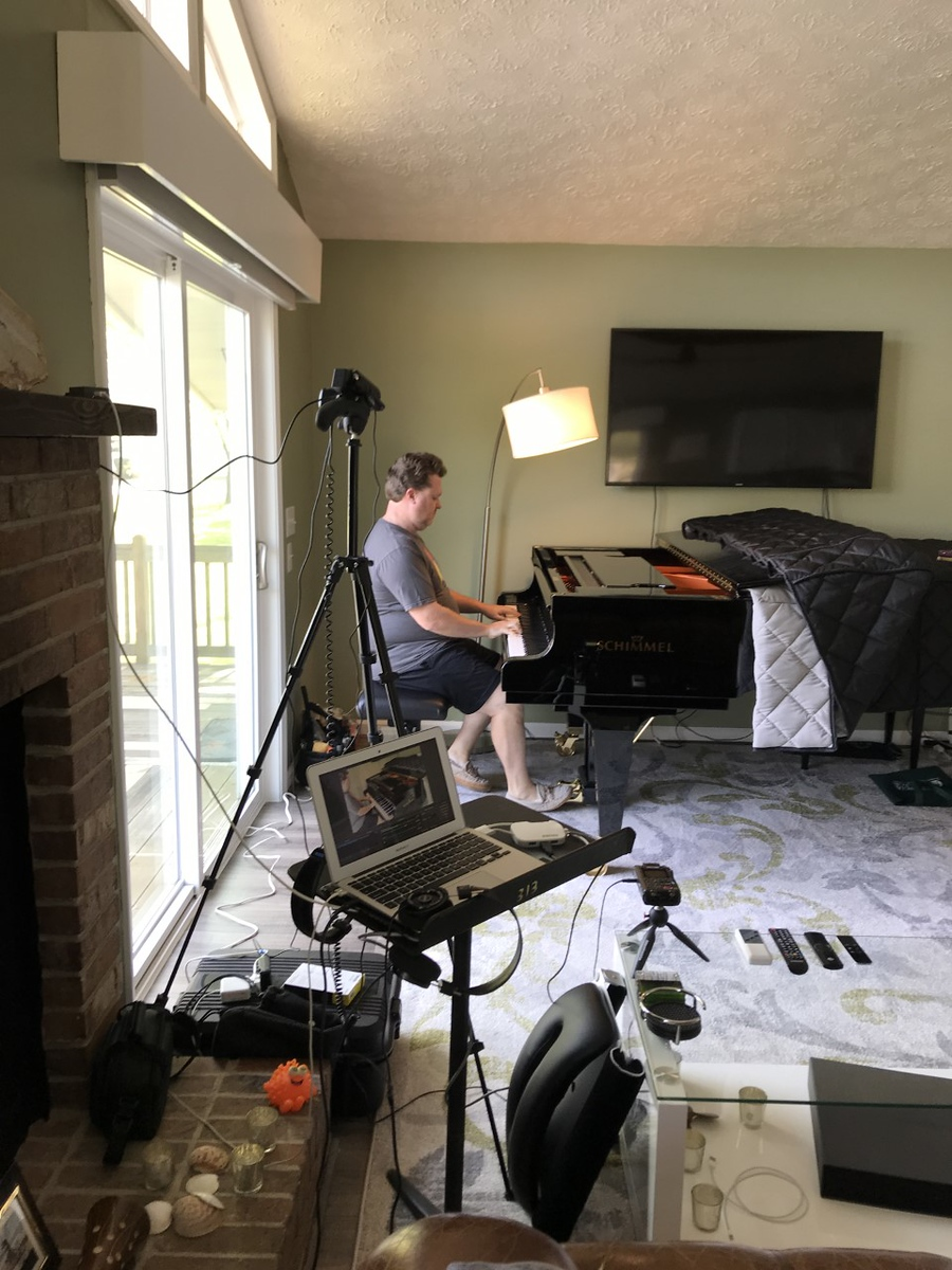 Dr. Owen Lovell practices on his grand piano at home.