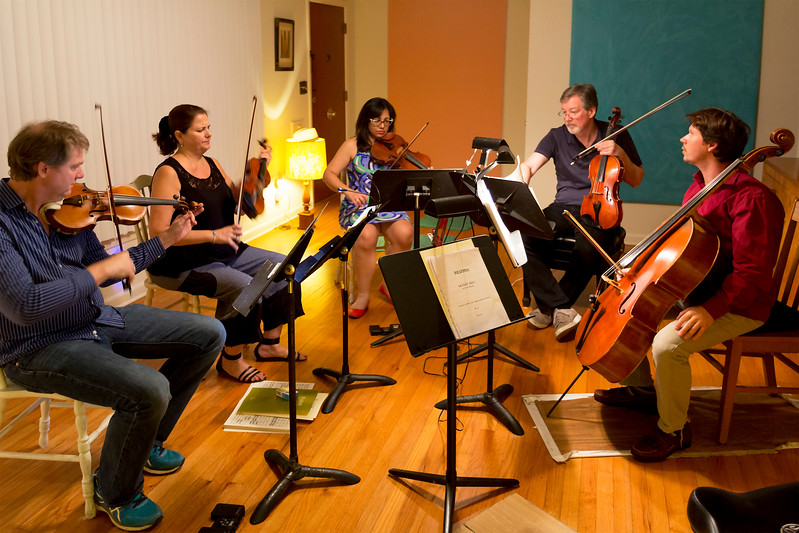 The full ensemble rehearsing