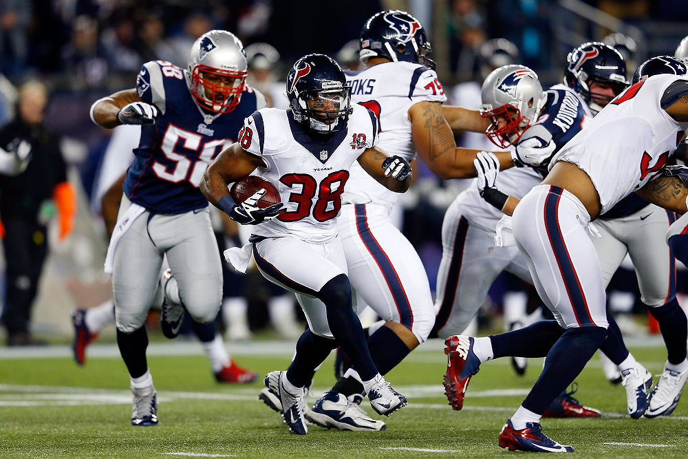 Description of . Danieal Manning #38 of the Houston Texans runs with the ball against the New England Patriots during the 2013 AFC Divisional Playoffs game at Gillette Stadium on January 13, 2013 in Foxboro, Massachusetts.  (Photo by Jim Rogash/Getty Images)