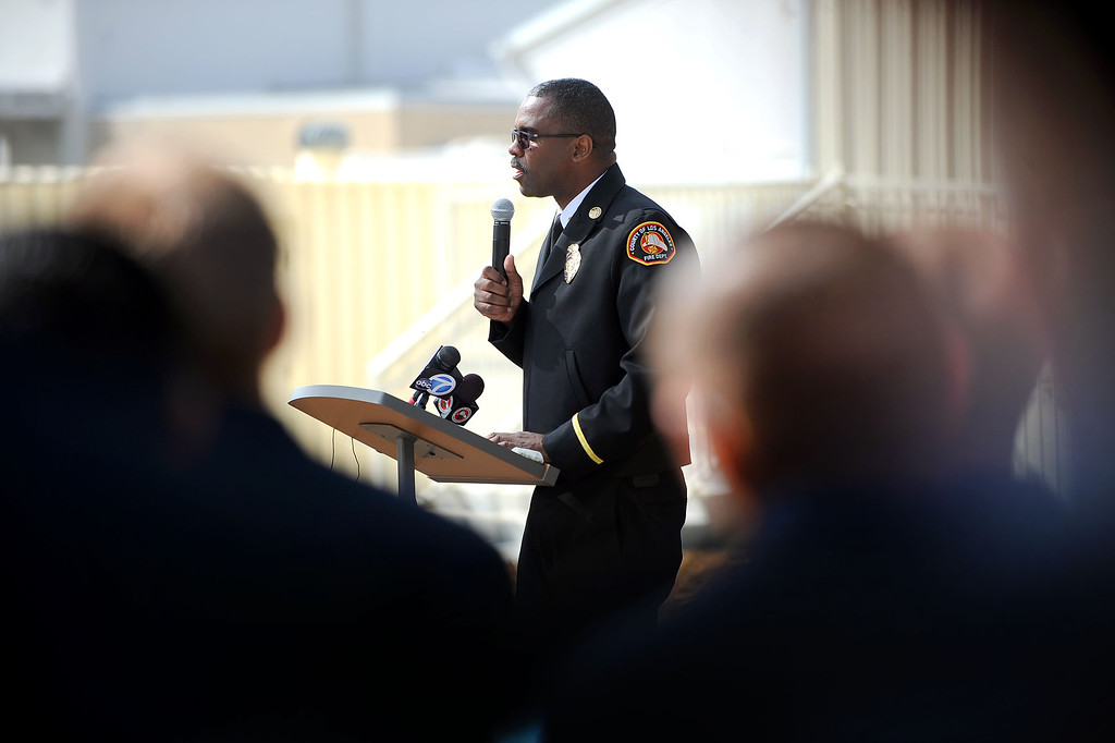 . LA County Fire Chief Daryl Osby speaks during the 20th Anniversary Memorial Ceremony for firefighter Jeff Langley March 28, 2013 at the Los Angeles County Fire Department Barton Heliport in Pacoima, CA.  Langley was killed during a 1993 Air Operations rescue in Malibu.(Andy Holzman/Staff Photographer)