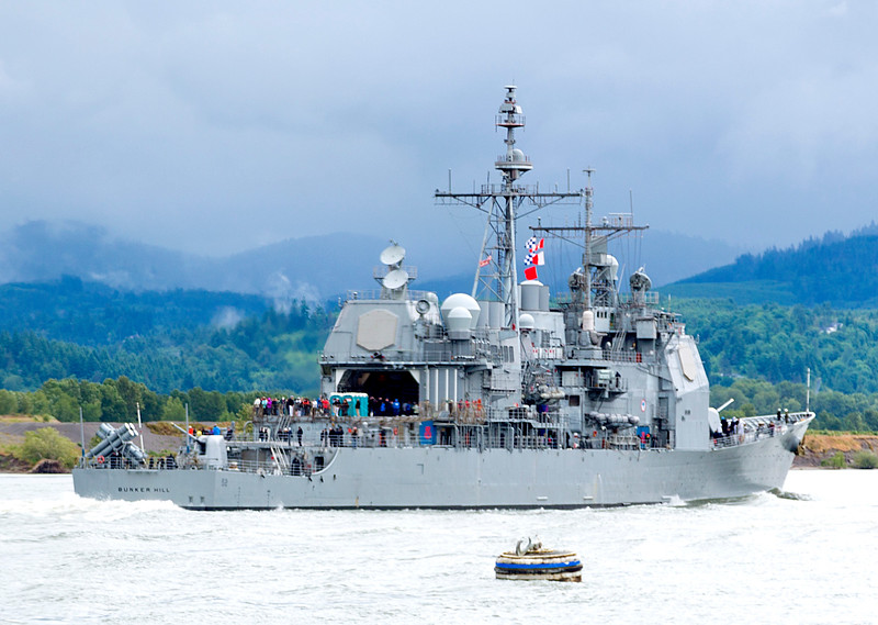 A destroyer, headed to Portland for the Rose Festival, passes us.