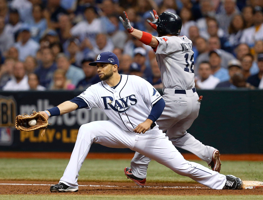 . Boston Red Sox\'s Shane Victorino (18) is safe on first base as Tampa Bay Rays first baseman James Loney (21) catches the throw in the seventh inning in Game 4 of an American League baseball division series, Tuesday, Oct. 8, 2013, in St. Petersburg, Fla. (AP Photo/Mike Carlson)